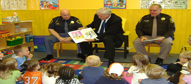 Chief Agay  L   Prosecutor Cotter  Sheriff Bailey  R  reading at Witheral School